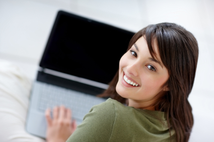 Attractive young female using a laptop